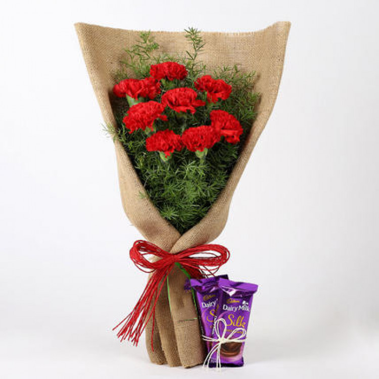 8 Red Carnations & Dairy Milk Silk Combo